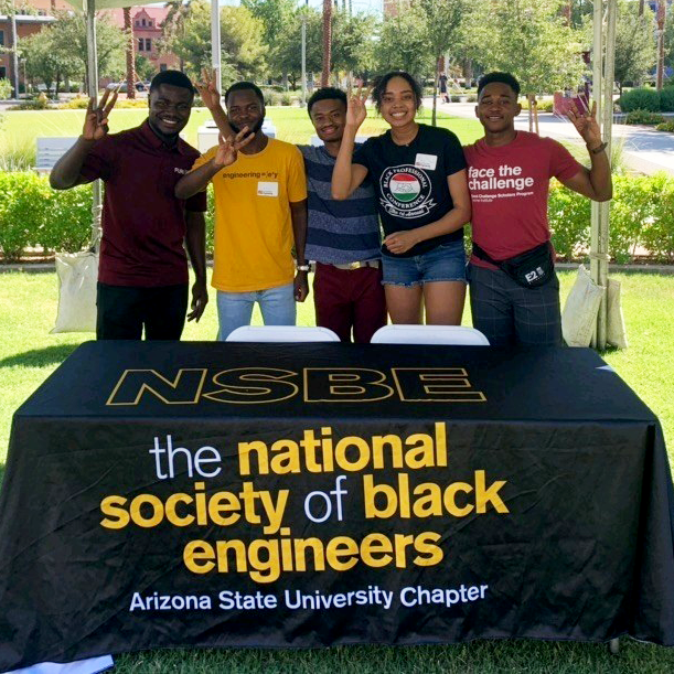 National Society of Black Engineers team members working a stand at fall welcome org fair